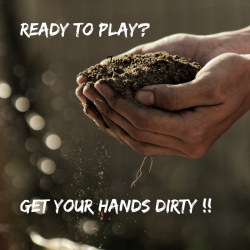 Cupped hands in dirt